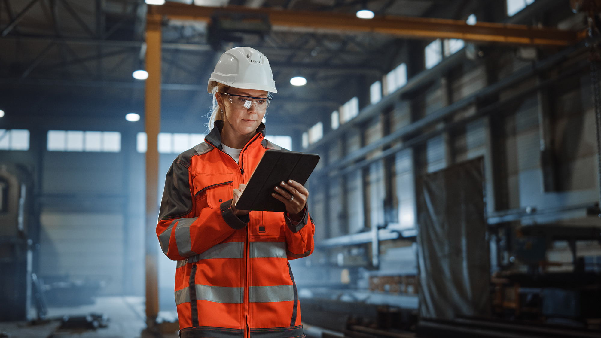 woman with tablet in factory